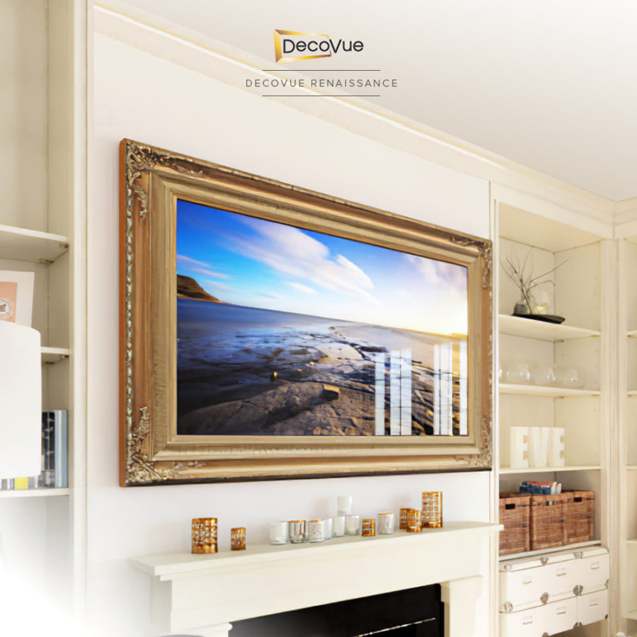 A smart TV in gold decorative frame hanging on a living room's wall just above the fireplace.