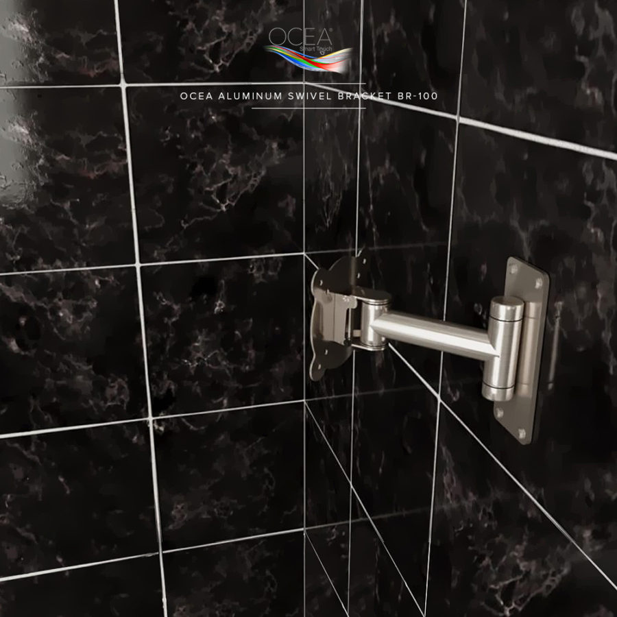 Aluminum TV mount bracket installed in a black marble design shower.
