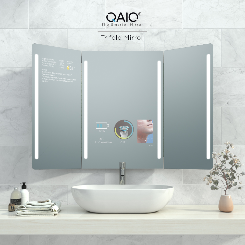A smart vanity mirror with three fold displays where 2 screens are on while the other one is turned off.
