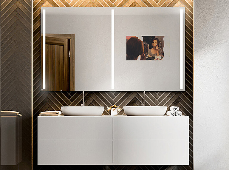 A double vanity mirror TV with intregrated light.
